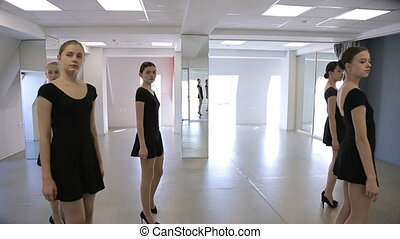 In model school females are walking up and down. Showing,...
