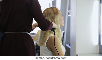 In model school woman is preparing to fashion show. Woman is...