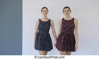 In model school young females is walking on runway.
