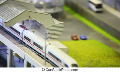 in modern toy city train goes by rail from station