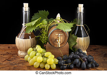 In oak casks with vines and grapes white and black...