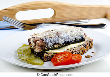 in oil, pickled sardine on a slice of wholemeal bread