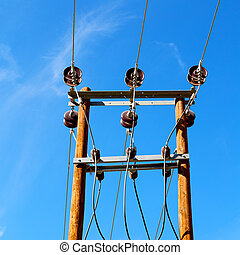 in oman the electric cable wood pylon energy and current ...