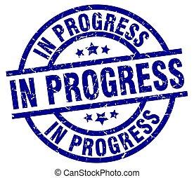 in progress blue round grunge stamp