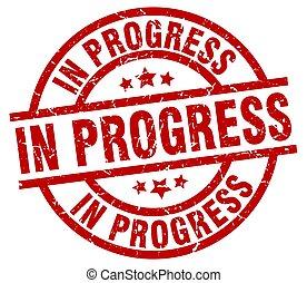 in progress round red grunge stamp