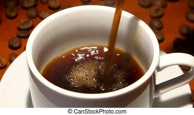In pure white cup of poured hot black espresso. Closeup - In...