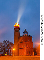 In rainy night shinning lighthouse Cap Arkona on Ruegen ...