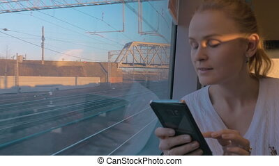 In Saint-Petersburg, Russia in train rides young girl and looking out the window