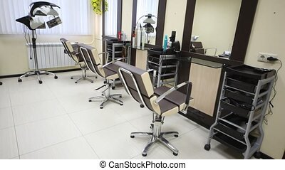 In salon hairdressing salon there are three workplaces and dryer for hair