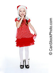In Santa Claus cap little girl in red dress and shoes mother's