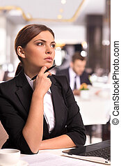 In search of new business ideas. Thoughtful young woman in ...