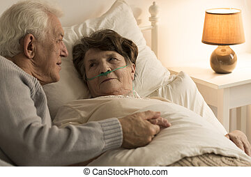 In sickness and in health - man comforting sick wife