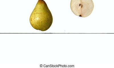 Pear segments plunging into water - in slow Pear segments...