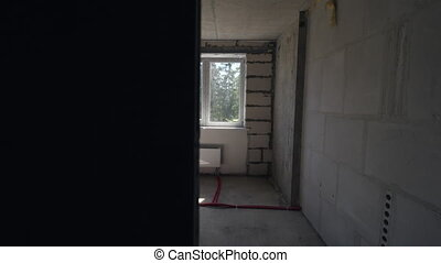 In the apartment of unfinished house - Apartment house under...