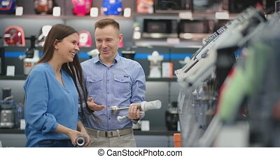 In the appliances store, the couple is fooling around and...