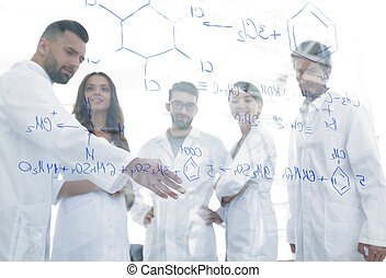 in the background image group laboratory scientists...