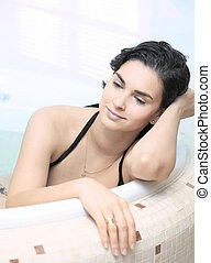 In the Bathtube - Young women is daydreaming in the bathtub.