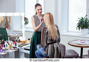 Nice attractive woman looking at her client