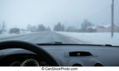 in the cabin of the car while riding in winter.