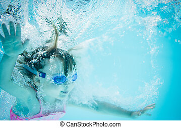 In the deep - girl swimming underwater