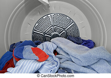 In the Dryer. - Guy clothes and towels in the dryer. Fresh,...