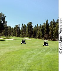 Golf carts on the fairway at an Oregon golf course