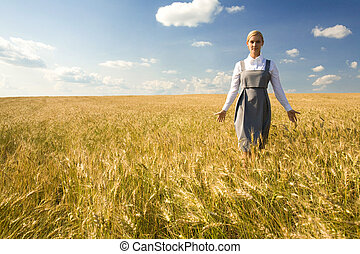 In the field of gold - Smart female walking in wheat field...