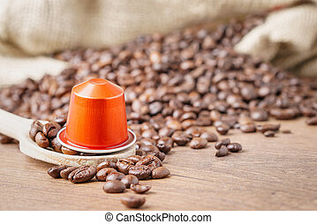 coffee capsule on wooden spoon