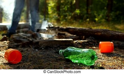 In the foreground in a forest glade there are plastic...