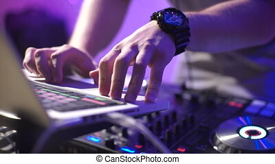 In the frame the DJ's hands in a nightclub. The party is in...