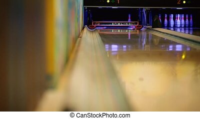 In the game club for bowling, the player throws a bowling...