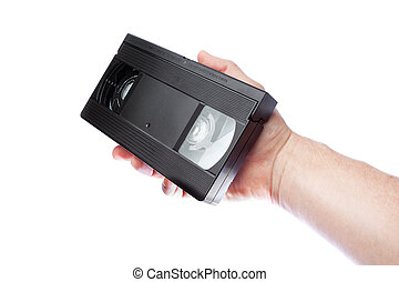 In the hand of a man old videotape format VHS.