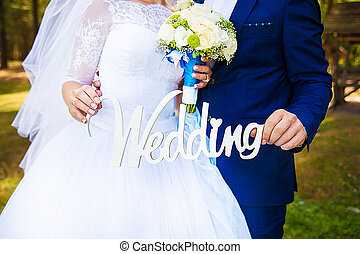 in the hands of the newlyweds wedding wooden letters
