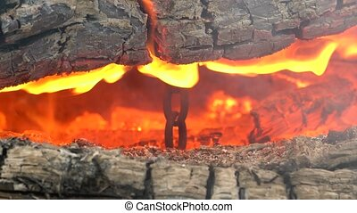 In the hot flames of the fire between the logs you can see a...