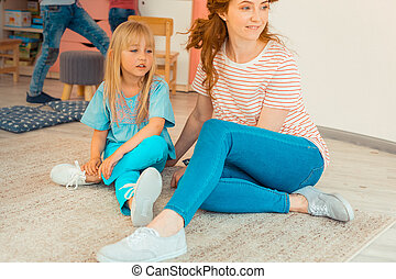 Cute blonde girl sitting on the floor