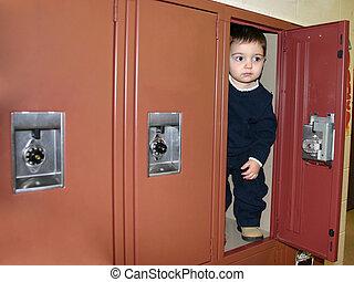 Small boy stuffed in a school locker.