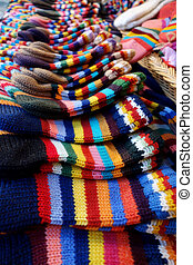 In the market a wide selection of different colored hand-knitted socks.