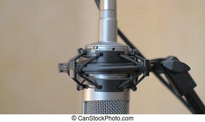 In the music studio - Studio condenser microphone close-up....