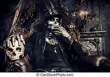 in the old castle - Halloween. A man with a skull makeup...