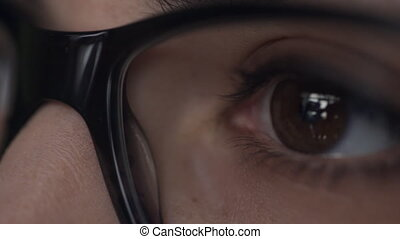 In the optics salon, a patient with glasses is checked for...