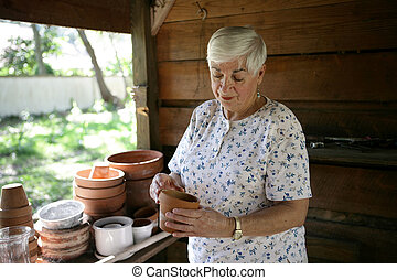 In The Potting Shed - A senior lady gardening in her potting...
