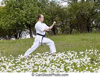 In the rack karate an athlete in karategi