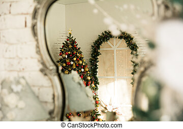 In the reflection mirror Christmas tree