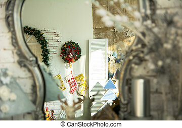 In the reflection mirror Christmas wreath