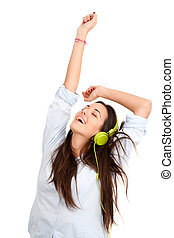 In the rhythm with headphones. - Young woman dancing in the...