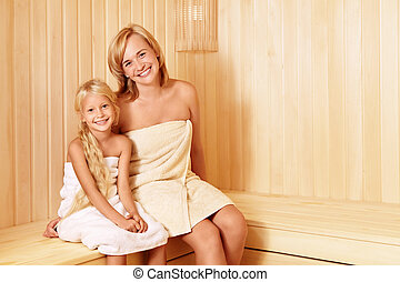 In the sauna - Mom and daughter in the sauna