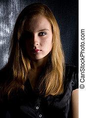 In the shadow - Pretty girl in a black dress in the dark...