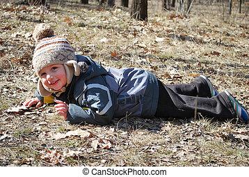 a little boy on the ground leit