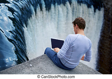 In the streem of inspiration - Man with notebook sitting at ...