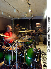In the studio 2 - A bass player, guitar player and drummer...